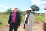 Bishop Christopher and Bishop Godfrey on our visit to Chidzikwe.  They are both wearing Masvingo ten year celebration hats to keep off the sun!