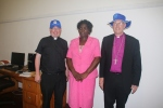 Hats are always useful when it is hotl  Here are Bishop Christopher with MArk Steadman (in their MU hats) and the Dean's wife