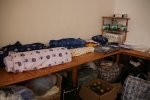 The storeroom at MU House with material and other goodies for sale