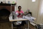 Bahle Ngangura and one of the sewing machines